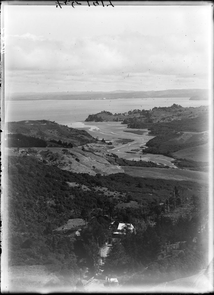 View from Exhibition Drive across the Manukau Harbour showing Big Muddy Creek, Parau and Huia Road. Feb 1920. Sir George Grey Special Collections, Auckland Libraries, 4-4082