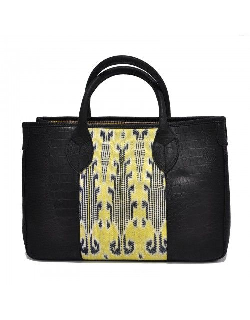 A striking handbag that fits most things you'll need, day in day out. A classy touch of colour for the workplace and after work functions.  Black and yellow Tenun Ikat weave fabric paired with black Italian leather.    Handmade in a workshop in West Java  by a group of meticulous artisans.