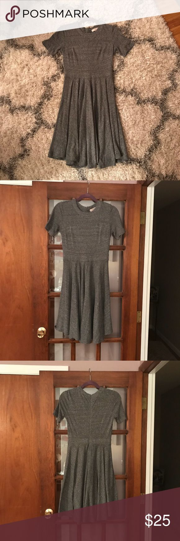Ann Taylor LOFT Gray Dress Ann Taylor LOFT Knit Grey Dress.  Flared at the end - Size 2 petite.  Light weight material.  Come from smoke free house.  Only worn a few times, great condition!  Willing to accept reasonable offers :) LOFT Dresses Asymmetrical