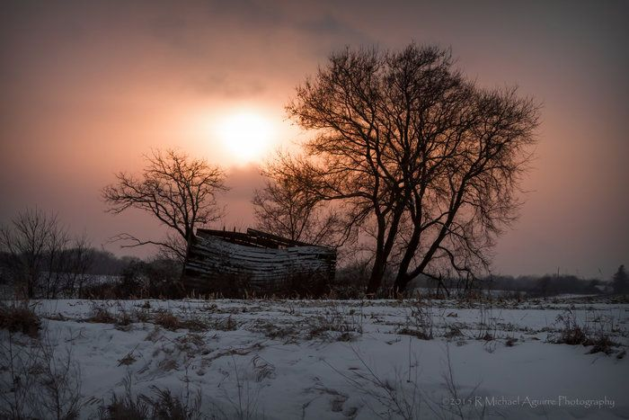 Sundown Flurries by Michael Aguirre on Capture Minnesota // A beautiful break in the dying flurries makes this sundown over a collapsed house a little unordinary to the end of a Minnesota Winter's day. It's like a little peace of Heaven shining down upon on the fallen structure.