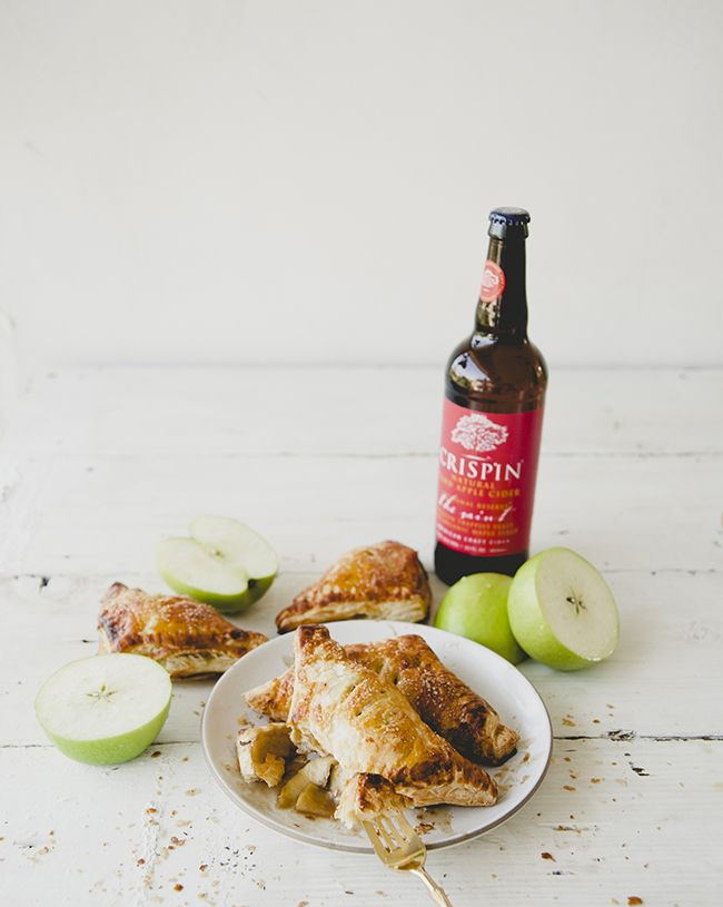 APPLE CIDER TURNOVER WITH A BOTTLE OF CRISPIN CIDER AND FRESH CUT GREEN APPLES…
