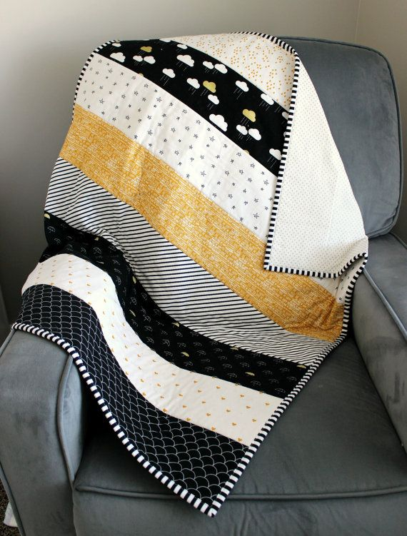 This ready-to-ship quilt measures approx 35 x 40. The front is Riley Blakes When Skies Are Grey black panel by Simple Simon & Company. The back is Gold Swiss Dots by Riley Blake. The binding is Dot and Dash Black Stripe by Doodlebug Designs for Riley Blake. This quilt would be great in the car, crib, stroller, or even tummy time. The fabrics were pre-washed for shrinkage and colorfastness. For care at home, use a mild detergent in a gentle cycle and dry on low/ medium heat. This listing is…