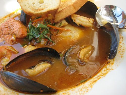 Bouillabaisse originates from Provence in France. An authentic bouillabaisse is made with a variety of Mediterranean fish, some of which are only available in the south of France. Regional variations use whatever fish is available locally. After cooking, the fish is usually removed and served on a separate plate along with Rouille, which is a prepared condiment. […]