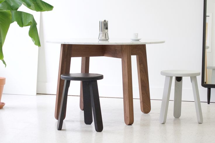 Stir Round Dining Table in Walnut with Carrara marble top. Shown with our modern stools