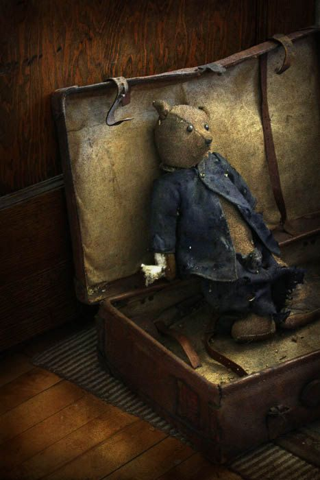 Love the well worn teddy in the vintage suitcase