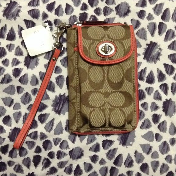 NWT coach wristlet with phone pocket Salmon/coral and tan colored coach wristlet. Perfect for on the go! Has plenty of room for some cash and cards inside. Coach Bags