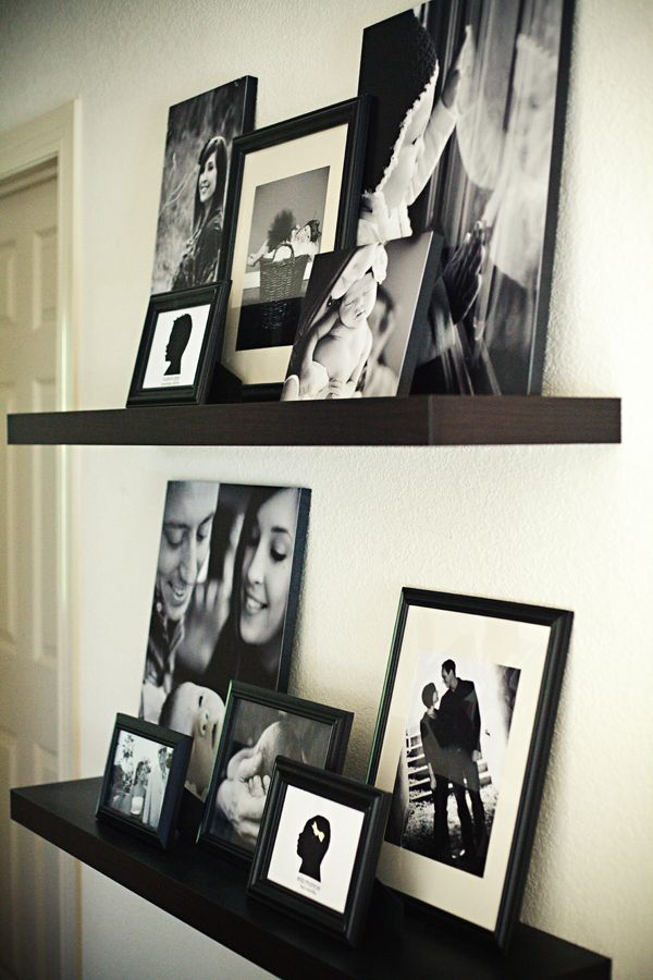 Pictures on floating shelf, I wouldn't go black and white but would find a unified color scheme