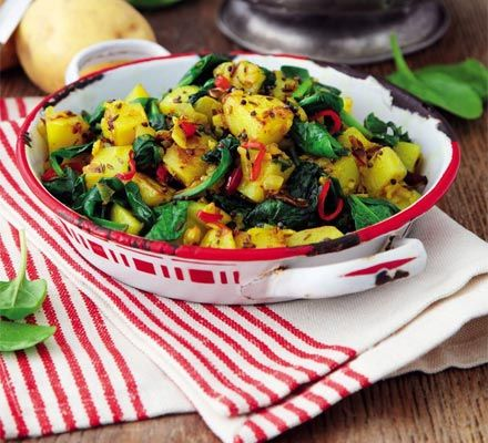 Sag aloo. Nutritious spinach makes the base for this traditional, healthy Indian side dish, combined with potato and spices