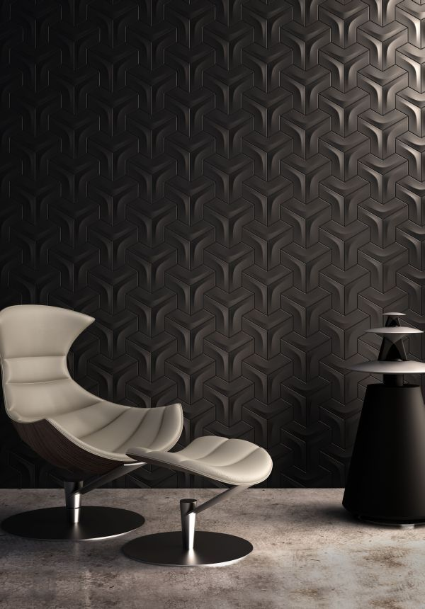 Textured wall finish combined with stark hardness of the floor plane is brilliantly set off by the ergonomic flow of  the chair / ottoman combo and their contrasting finishes.