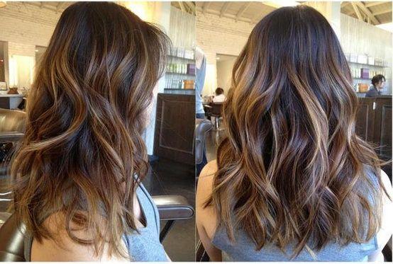 Long layer hair cut style, brunette caramel highlights, warm.