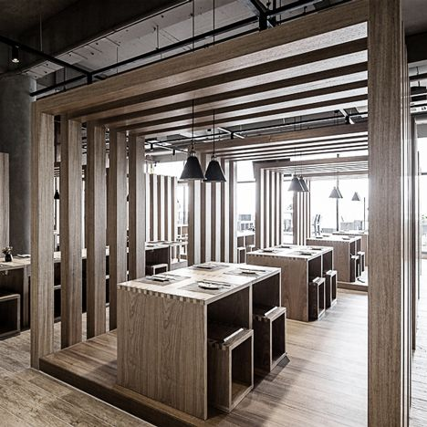 Wooden boxes surrounding the tables of this noodle bar in the Chinese city of Shenzhen frame views of the city skyline.