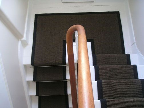 Stairs with a runner and landing in the same style as ours. Maybe do something like this?