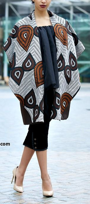 NEW Be Brown African print winter coat by Gitas Portal. The Be Brown coat is very warm, elegant and versatile. Wool and cashmere blend gives this coat it's luxurious feel. Ankara | Dutch wax | Kente | Kitenge | Dashiki | African print bomber jacket | African fashion | Ankara bomber jacket | African prints | Nigerian style | Ghanaian fashion | Senegal fashion | Kenya fashion | Nigerian fashion | Ankara crop top (affiliate)