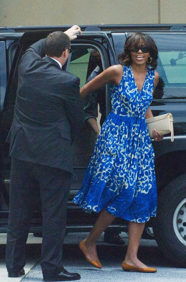 Pin for Later: 45 Genius Style Lessons We Learned From Michelle Obama Outfit Repeating Is Totally Underrated Wearing a blue-printed Tracy Reese dress and flats.