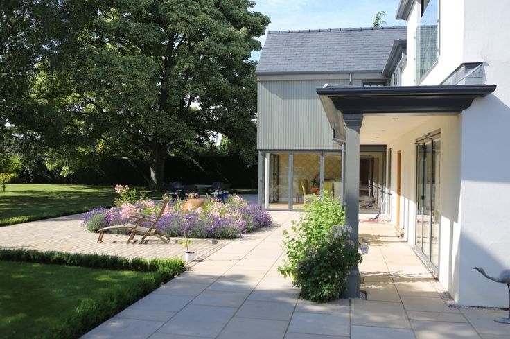 Ambulatory to a remodelled home in Ely. Painted timber cladding and sliding folding doors.