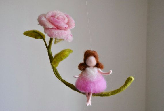 This is a Waldorf inspired piece made of wool by the needle-felting technique. Its been created to provide a peaceful and harmonious image that communicates with the soul through its colors, textures, forms and energy. Dimensions: 7 in height, 11 in width. Doll: 4.5 in. SHIPPING: Since shop-home is located in Montréal, contact the shop owner for more accurate delivery-time and shipping-costs. Note: it is not a toy.