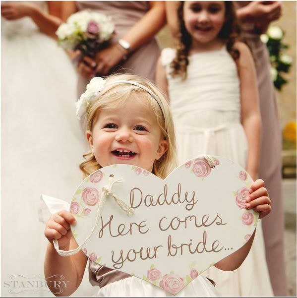 "Wooden heart ""daddy here comes your bride"" sign hand-painted to match this couple's dusky pink vintage rose and lace wedding.  Held by the most beautiful model ever!    Sign painted by www.paintedwithlove.co.uk  Photography by http://www.classicphotogallery.co.uk/"