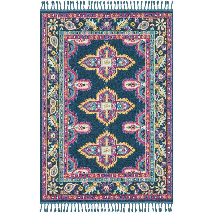 The vibrant and eclectic designs inspired by Moroccan patterns in World Menagerie's Crew collection will set your space apart with a splash of color and edgy style. The tight patterns and vibrant untraditional colors in this fringed polypropylene rug are sure to catch the eye of visitors. Featuring a medium pile, this rug is perfect for high-traffic areas with minimal shedding. Rug pad recommended.