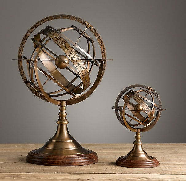 """Restoration Hardware - 18th C. Brass Armillary $149 - $295 Often credited to Eratosthenes, a mathematician and geographer of ancient Greece, the armillary sphere served as a model of the known universe before the advent of the telescope. Ours, crafted of brass, is a reproduction of a French antique. Small: 7"""" diam., 11""""H Large: 14"""" diam., 20¼""""H"""