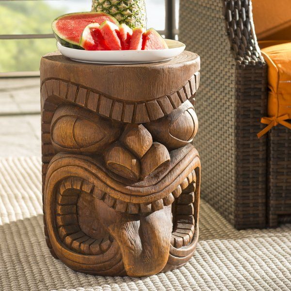 Bring a taste of island style to your backyard with this sculptural Tiki side table. Made from cast resin in a tropical brown faux-woodgrain finish, this weather-resistant design is inspired by Polynesian carvings found scattered throughout islands in the South Pacific Ocean. For an equatorial ensemble on your patio or back deck, start by rolling out a palm-frond print area rug to define the space, then arrange a wicker loveseat and armchair with padded cushions around a bamboo cane coffee…