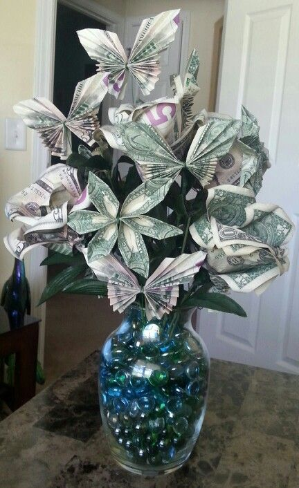 Money Origami Bouquet! Made with $137. Money roses(5 bills each), butterflies (2 bills each) and pinwheels(3 bills each) A fun way to give the gift of cash!  My sister loved her graduation gift!  Also great for mother's/father's day, birthdays or weddings! Follow Christina Waller for more great ideas!