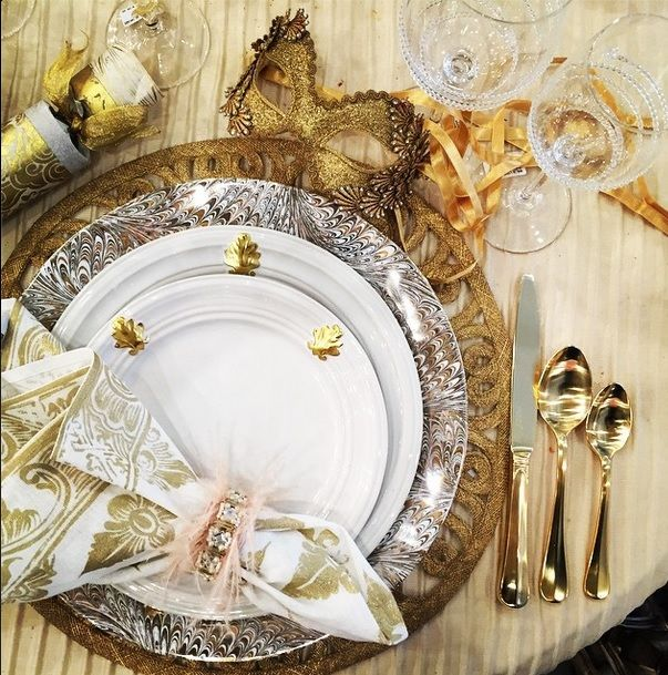 A festive holiday setting of gold, platinum and white with our new Acanthus Gold dinnerware collection and Firenze Medici charger, Bistro Gold flatware, Florentine Gypsy napkin and Amalia Sommlier wine goblets. #juliska #juliskajoy #forallthingslovely #tablesettings #tableware #gold #bling #happyholidays