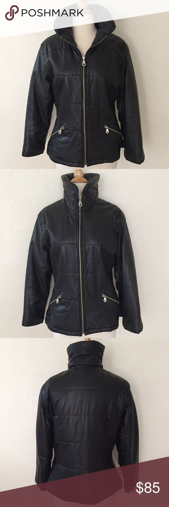 Andrew Marc vintage leather jacket Andrew Marc leather jacket from the 90's with soft, buttery panels, silver toned hardware, vertical zippers on cuffs, side pockets and a high padded collar. Pre-loved but in excellent condition. Size XS. Andrew Marc Jackets & Coats