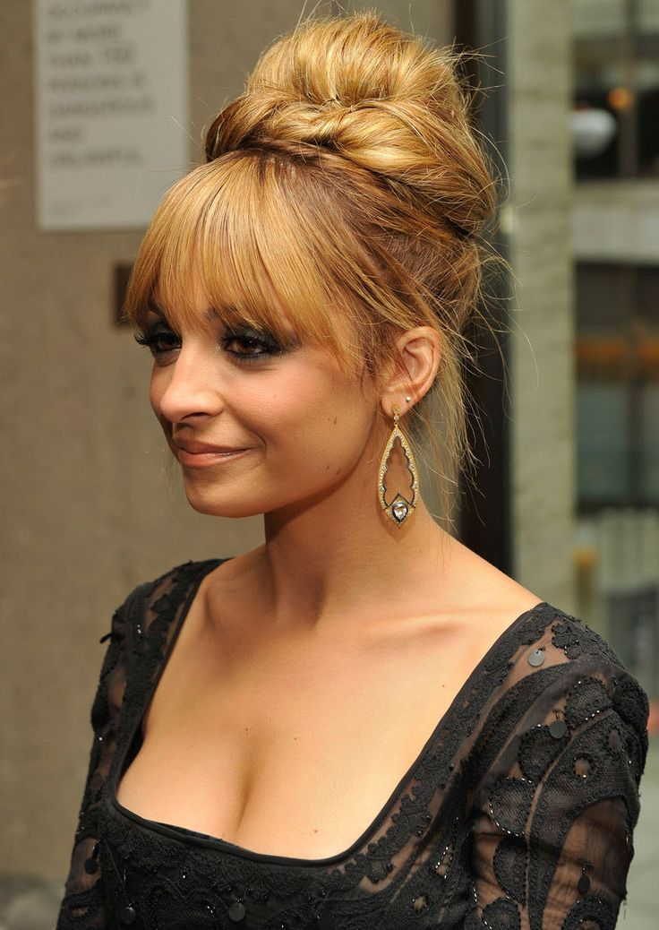 Nicole Richie Easy Updo Hairstyle-This  upstyle is teased at the roots to achieve maximum height and lift at the roots making this style great for those looking for a formal style to compliment a round face shape. The bangs are smoothed out to frame the top of the face and completes the over-all style magnificently.  First a mix horsetail, then rotation hair, using the clincher hair.