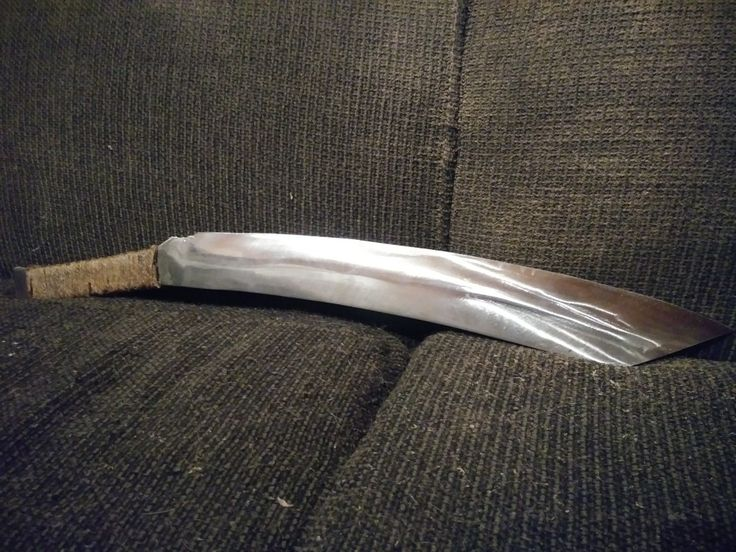 This is a spring steel machete with a jute cord rap that I sealed with epoxy.