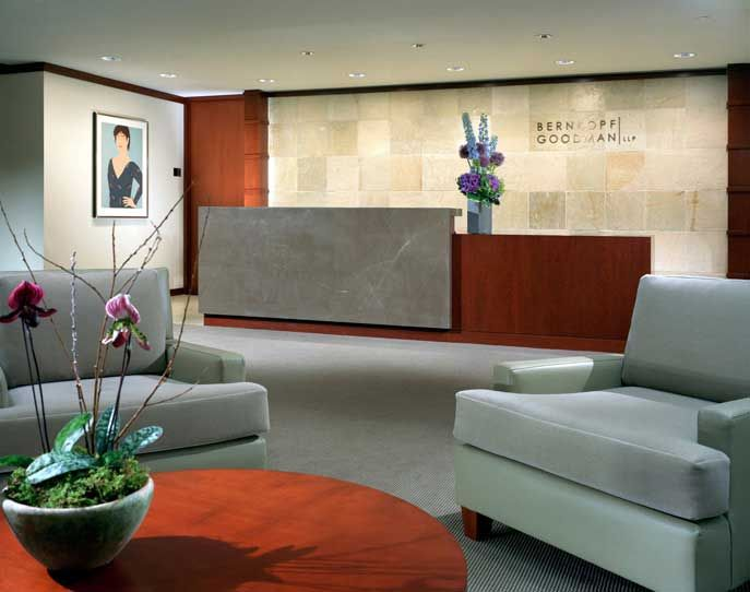 Focal wall with firm name behind a great reception desk for Interior design law office