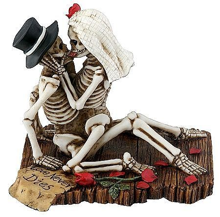 Love Never Dies Skulls Making Out Wedding Cake Topper. This striking gothic skeleton bride and groom will make a bold statement on your wedding cake. They are delicately handpainted and decorated with blood red roses, and a love note saying Love Never Dies. Perfect for any fantasy or gothic themed wedding! $24.95