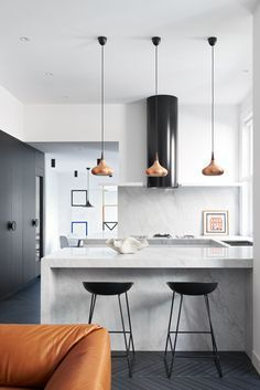 CONTEMPORARY minimalist kitchen decor, particularly love the marble breakfast bar and overhanging lights.