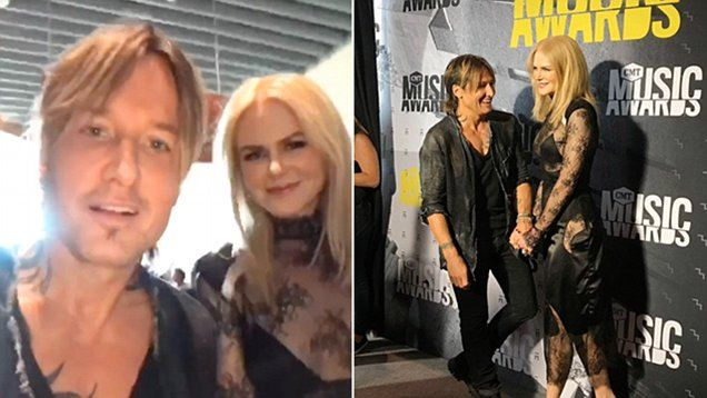 Keith Urban and Nicole Kidman at the 2017 Country Music Television Awards red carpet meeting with fans before performing with Carrie Underwood. Nicole has a goth look to her outfit.