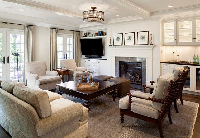 Family Room Furniture Ideas. Family room remodel featuring custom oak floors, a coffered ceiling, wet bar, and gas fireplace. #FamilyRoom