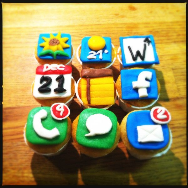 Cup cakes decorated as iPhone icons