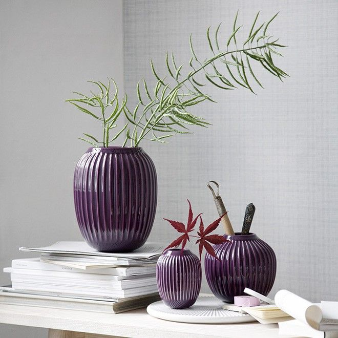 The beautiful vases in Kähler's Hammershøi range are now available in a deep, warm plum, which creates a beautiful contrast to the grey tones of Scandinavian interior design's cool universe. The Hammershøi vases have the characteristic furrows, which let the glaze spread beautifully over the surface and give an exciting, dynamic look with various shades of violet.