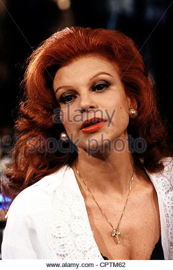 Milva (born Maria Ilva Biolcati), * 17.7.1939, Italian singer, portrait, 1990, red hair, necklace, cross, - Stock Image