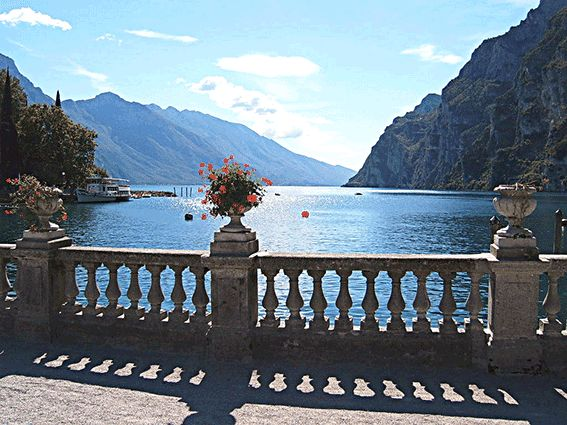 One of Italy's most picturesque and well known lakes, Lake Garda lies at the foot of the Trentino Alps.  Framed by the backdrop of rugged misty mountain tops, this spectacular shimmering lake is one of the most popular destinations in Italy and definately one you don't want to miss!
