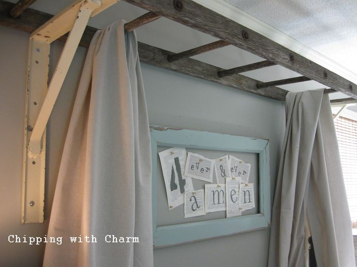 Ladder above bed with cloth hangings