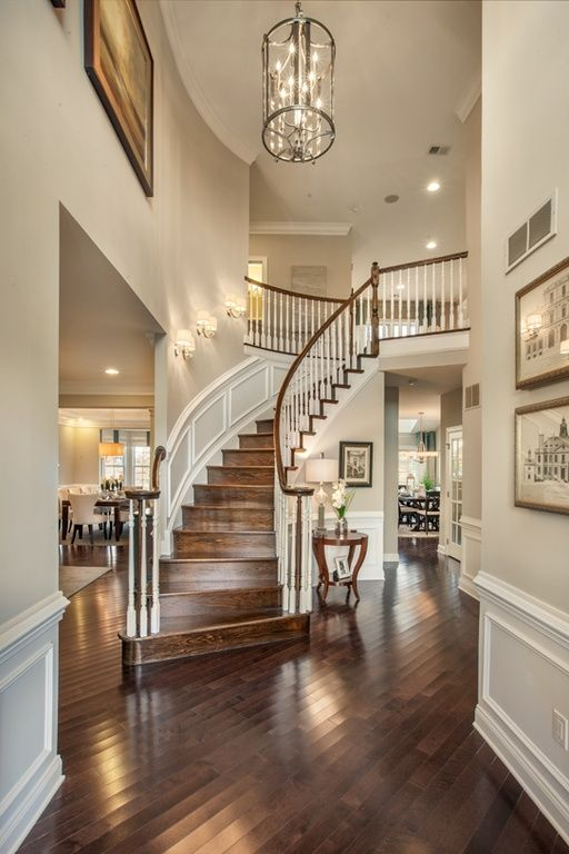 Traditional Entryway With Wainscoting High Ceiling Chandelier Dark Hardwood Floors Wall Color
