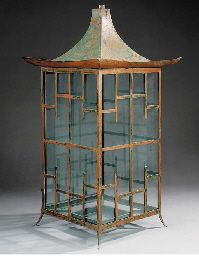A chinoiserie style iron lantern, 20th century   Of pagoda form, with tapering cover, the rectangular frame with lattice panels  47in. (119.3cm.) high