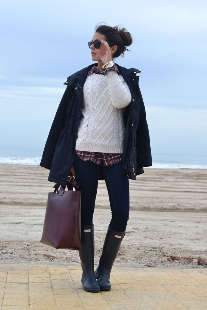 Shop this look on Lookastic:  http://lookastic.com/women/looks/parka-cable-sweater-dress-shirt-watch-sunglasses-skinny-jeans-tote-bag-rain-boots/8159  — Navy Parka  — White Cable Sweater  — Burgundy Plaid Dress Shirt  — Gold Watch  — Black Sunglasses  — Navy Skinny Jeans  — Burgundy Leather Tote Bag  — Black Rain Boots