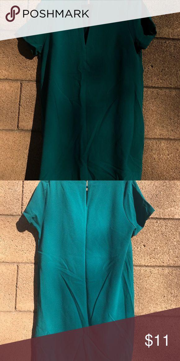 Emerald green dress Emerald green dress. V-neck cut out. Knee length dress. felicity & coco Dresses Midi