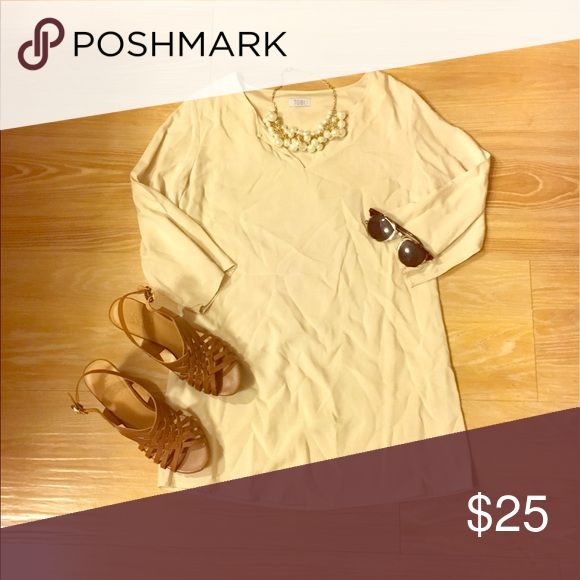 TOBI: NWOT beige mini dress 3/4 length sleeve beige mini dress. Has a V-neck. Great for a night out or to a nice dinner! Can be worn with heels or wedges! Light weight. Tobi Dresses Mini