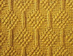 Moss Diamonds ... STITCHES: knit, purl, edge stitch ... PATTERN: 28 rows ... STITCH NUMBER: multiple of 14 + 1 + 2 edge stitches ... DIFFICULTY: medium