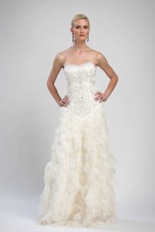Sue Wong   Strapless Ball Gown: $829     When you look at Sue Wong's wedding gowns, you'll see drama. Her vintage-inspired confections fashioned from silk, tulle, satin and lace are adorned with beads, feathers, petals and fringe. And she does it all for under $1,000. Her goal, she says, is to make every bride feel special, even if she doesn't have thousands to spend on a gown.