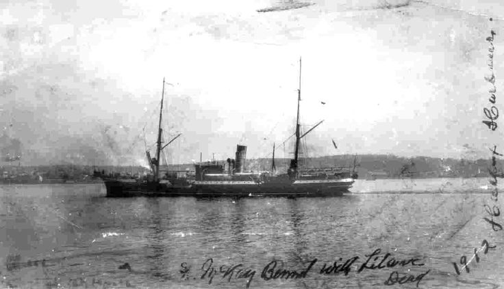 flags at half mast and coffins stacked on the stern, <b>Mackay</b>-<b>Bennett</b> ...