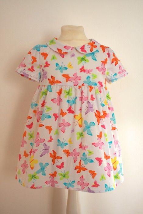 Kleid mit Schmetterlingen Gr. 104-110