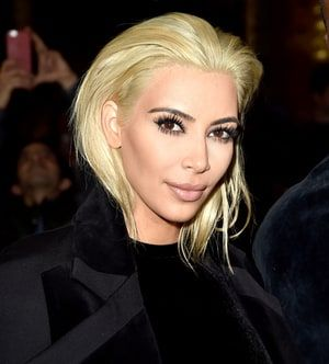 Kim Kardashian's colorist, Lorri Goddard, dished exclusively to Us Weekly on the reality star's blonde hair, the inspiration, and why it works