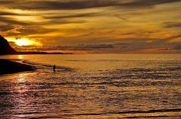 Fisherman at Sunset, photo by Carol Haberle, article for think-tasmania.com ~ #fishing #Tasmania #sunset